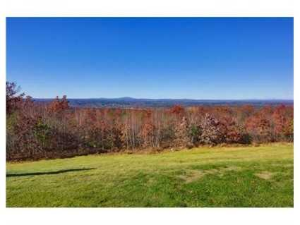 The home has a commanding 360 -degree view of western mountains and Boston skyline.