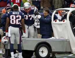 New England Patriots tight end Rob Gronkowski is helped onto a cart after being injured.
