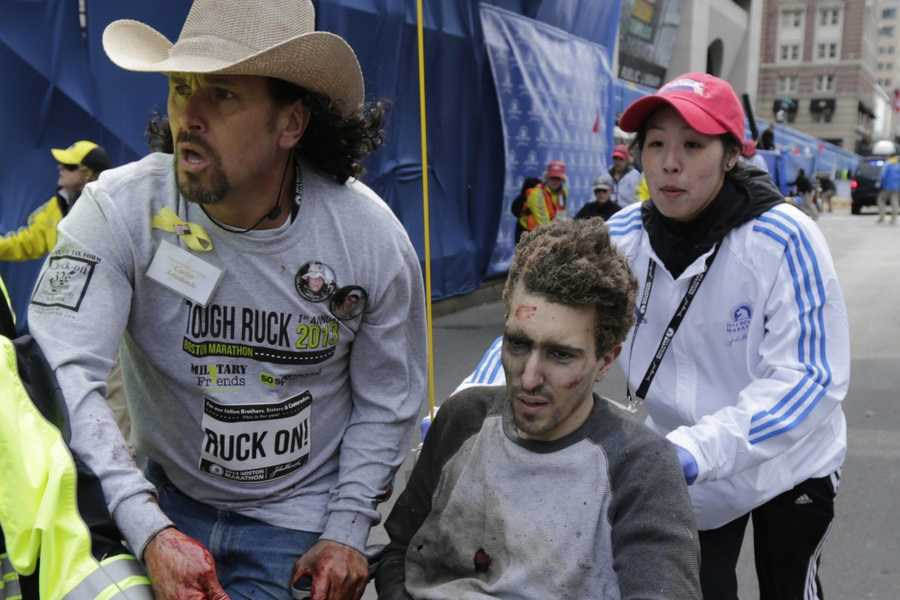 """Jeff Bauman lost his legs in the bombings was wheeled away with the help of Carlos Arredondo. """"Boston Strong"""" quickly became the rallying phrase in the aftermath of the blasts."""