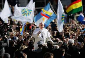 Pope Francis waves to crowds as he arrives to his inauguration Mass in St. Peter's Square at the Vatican on March 19.