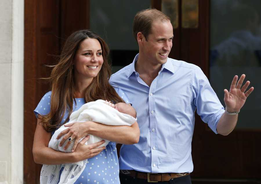 Britain's Prince William and Kate, Duchess of Cambridge hold the Prince of Cambridge, Tuesday July 23, as they pose for photographers outside St. Mary's Hospital.