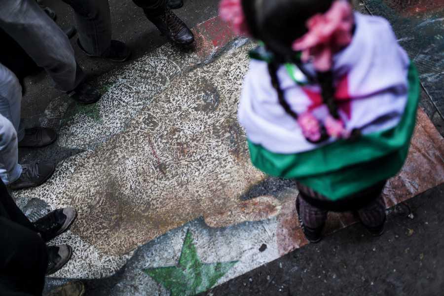 Syrians stomp on a portrait during a demonstration in the neighborhood of Bustan Al-Qasr, Aleppo, Syria, Friday, Jan. 4.
