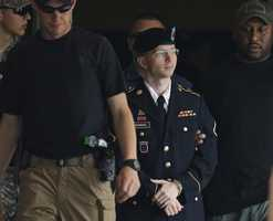 Army Pfc. Bradley Manning is escorted out of a courthouse in Fort Meade, Md., Tuesday, July 30, after receiving a verdict in his court martial. Manning was convicted of espionage, theft and other charges, more than three years after he revealed secrets to WikiLeaks.
