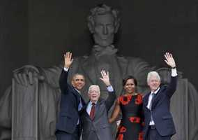 President Barack Obama, first lady Michelle Obama, former President Jimmy Carter and former President Bill Clinton wave as they leave 50th Anniversary of the March on Washington where Martin Luther King Jr., spoke, Wednesday, Aug. 28, at the Lincoln Memorial in Washington.