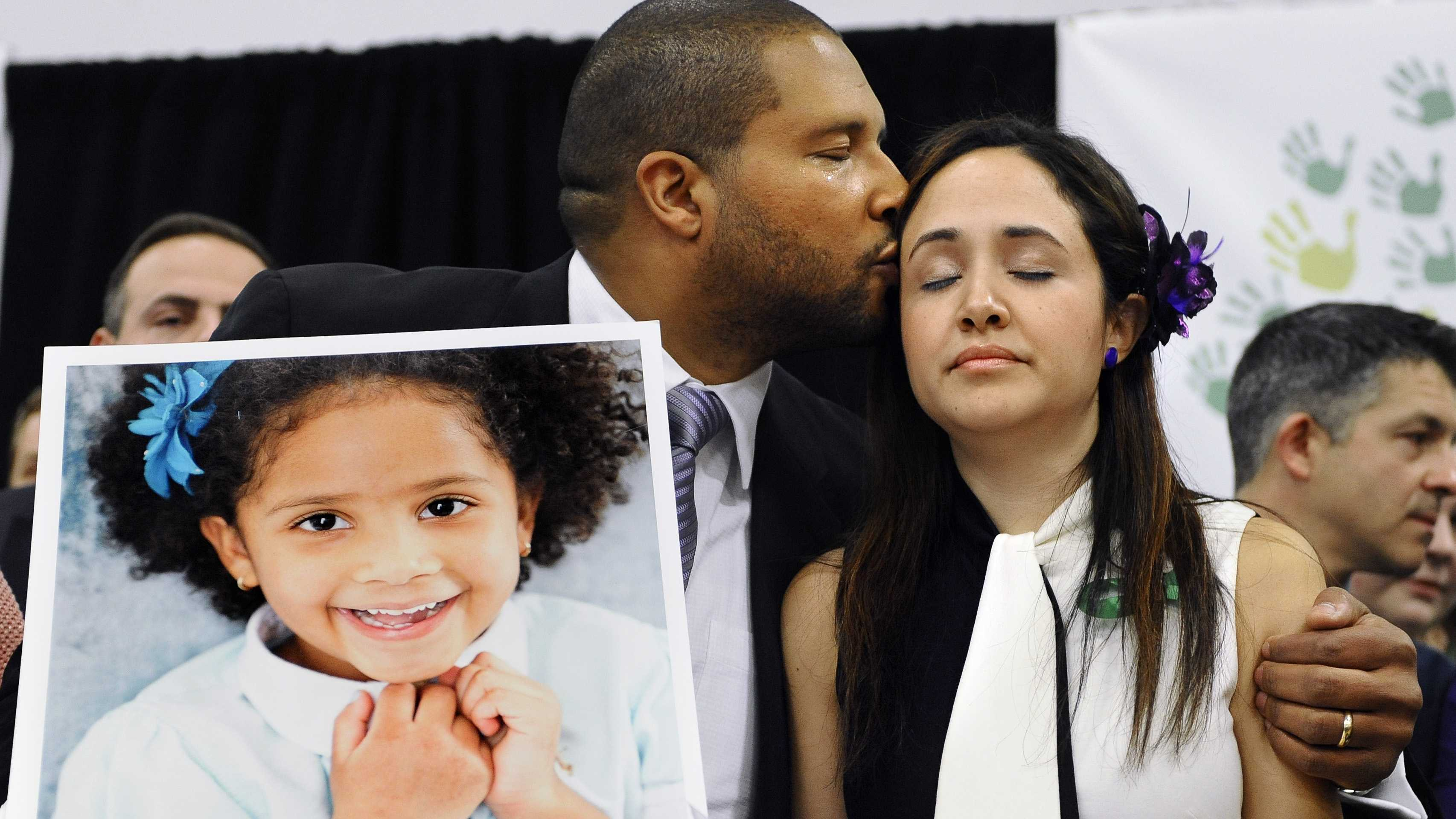Jimmy Greene holds a portrait of his daughter Sandy Hook School shooting victim Ana Marquez-Greene on Jan. 14, 2013. One month after the mass school shooting at Sandy Hook Elementary School, the parents joined a grassroots initiative called Sandy Hook Promise to support solutions for a safer community.