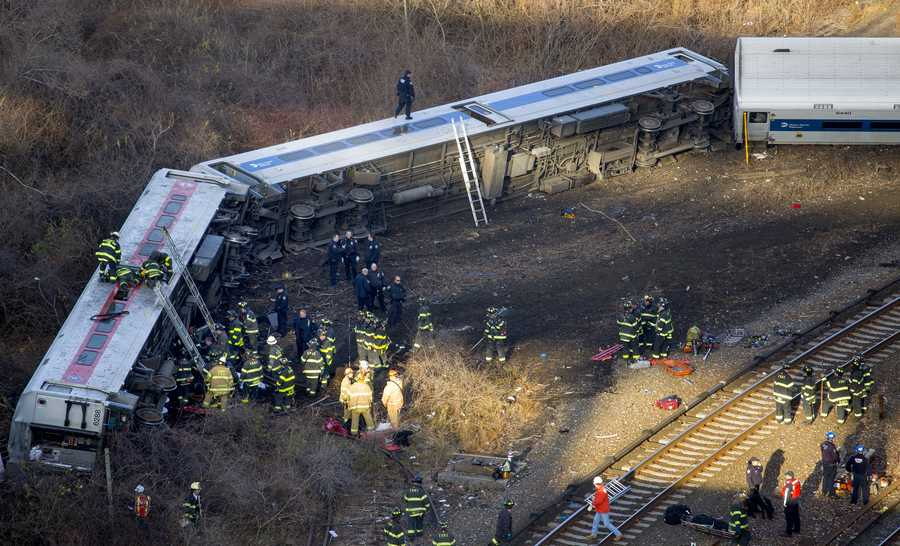 First responders work the scene of a derailment of a Metro-North passenger train in the Bronx borough of New York Sunday, Dec. 1, 2013.
