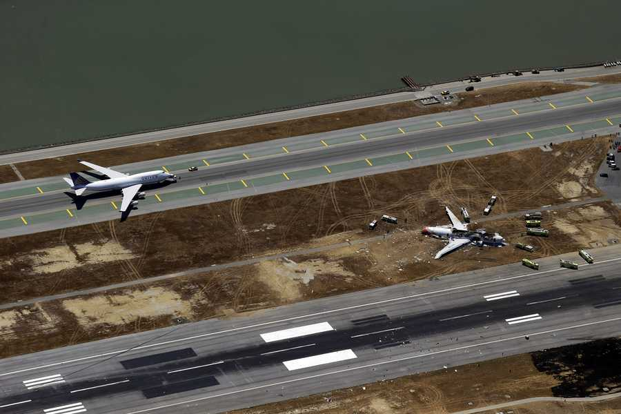 This aerial photo shows the crash site of Asiana Flight 214 at the San Francisco International Airport in San Francisco, Saturday, July 6.