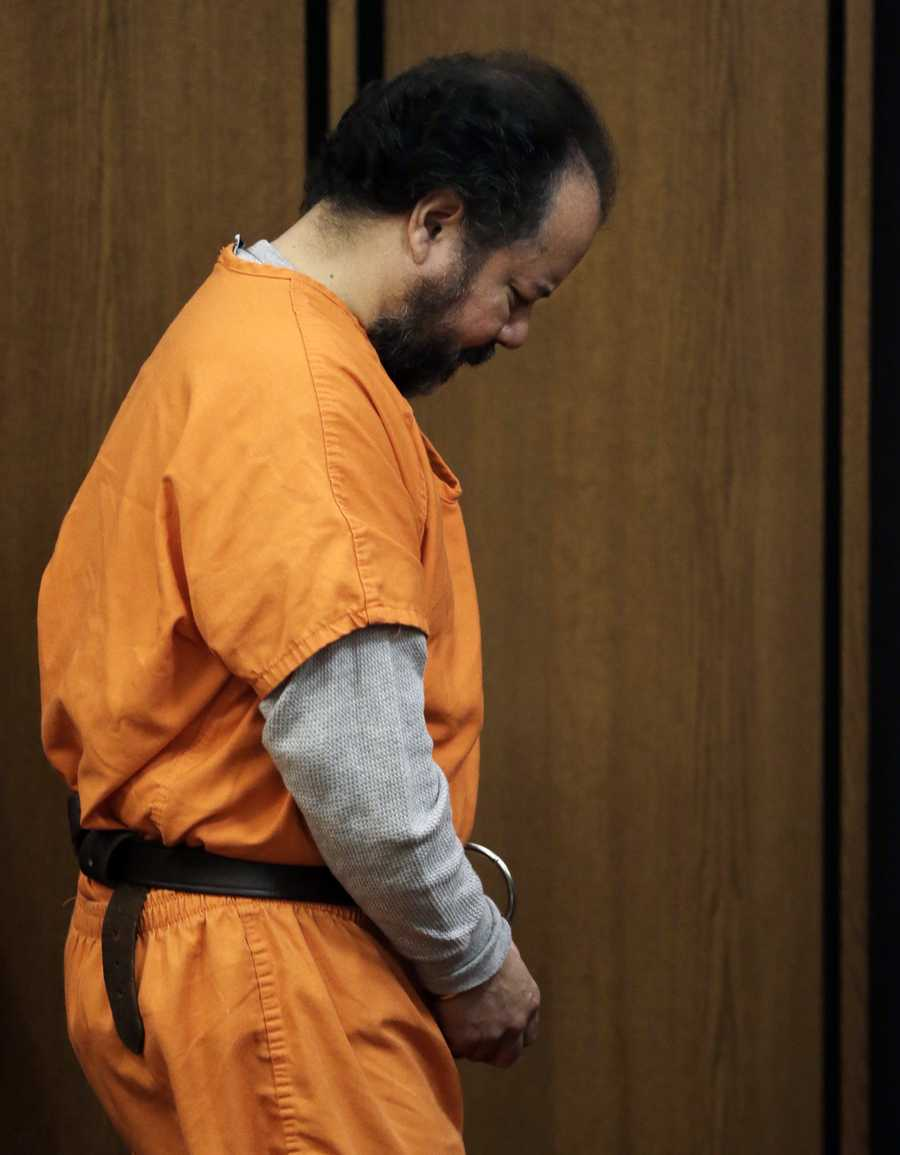 Ariel Castro walks into the courtroom Wednesday, July 2, in Cleveland. Castro pled guilty to 937 criminal counts of rape, kidnapping, and aggravated murder, as part of a plea bargain. He was subsequently sentenced to life in prison without the chance of parole, plus 1,000 years. One month into his sentence, prison guards found Castro dead in his cell after hanging himself.