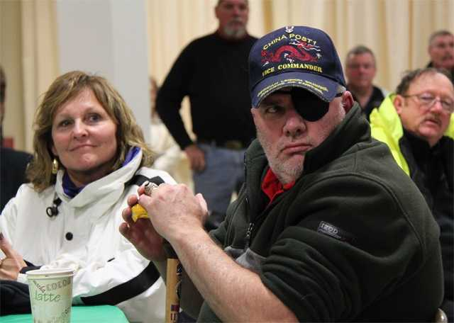 Veteran Alan Johnston of Windsor, Maine looks on as Ann LePage, wife of Maine's governor, sits beside him.