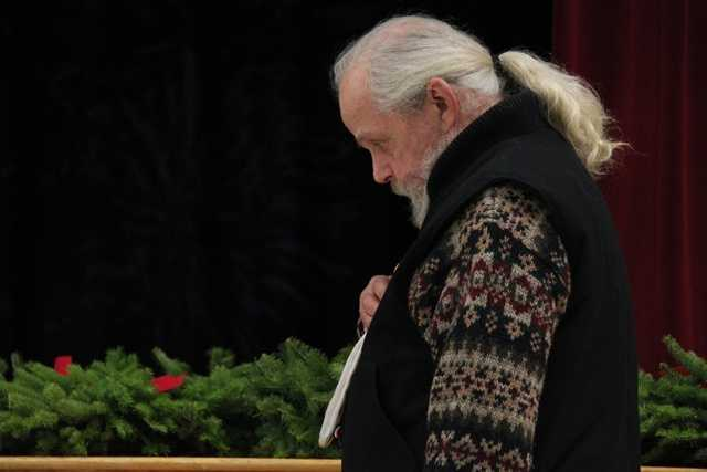 Veteran Tim Perkins of Boxford has his head bowed during the invocation.