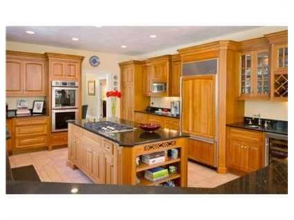 The gourmet kitchen is the hub and has both an over sized island, pantry and a breakfast bar.
