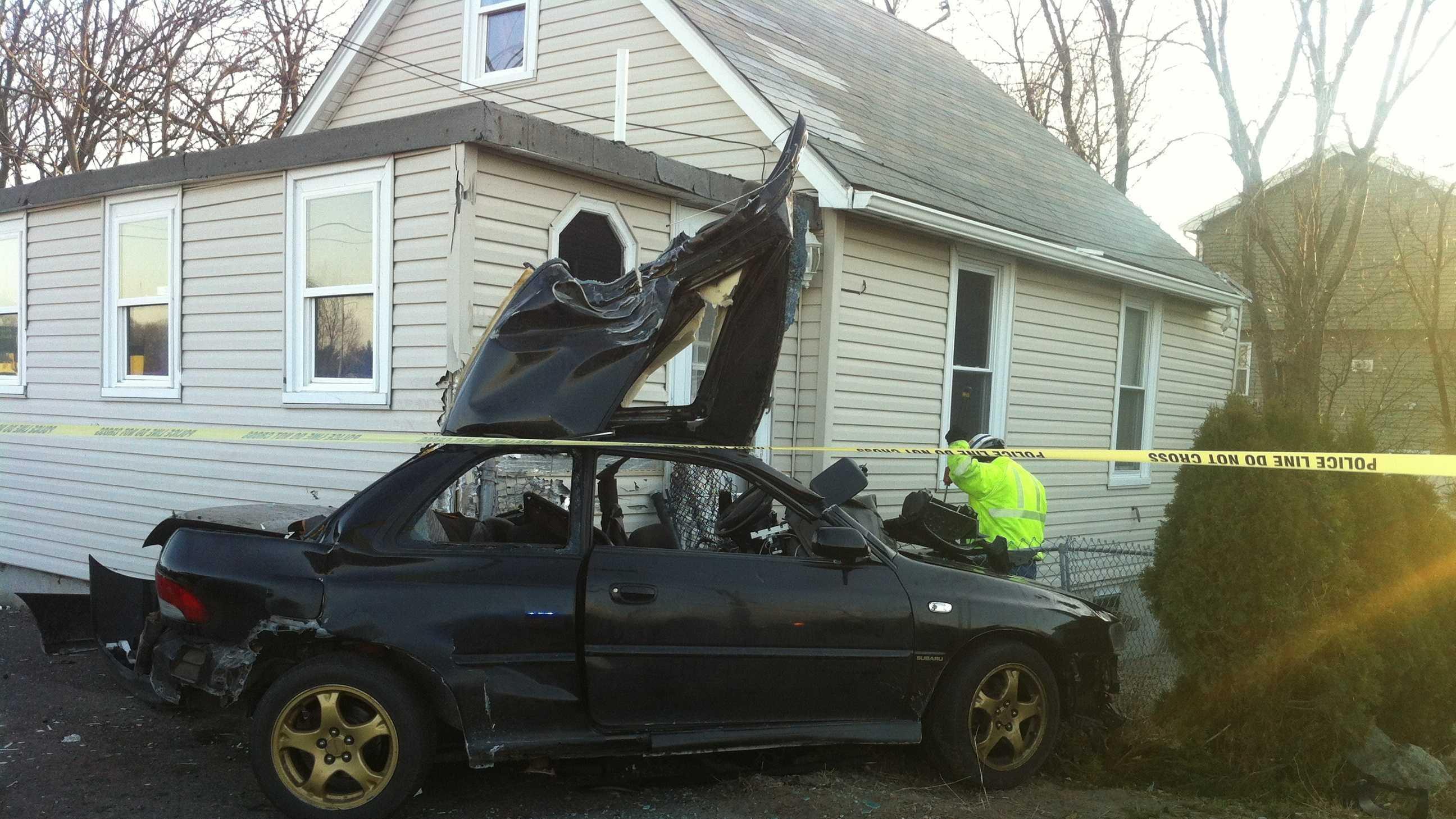 Revere car into house 2