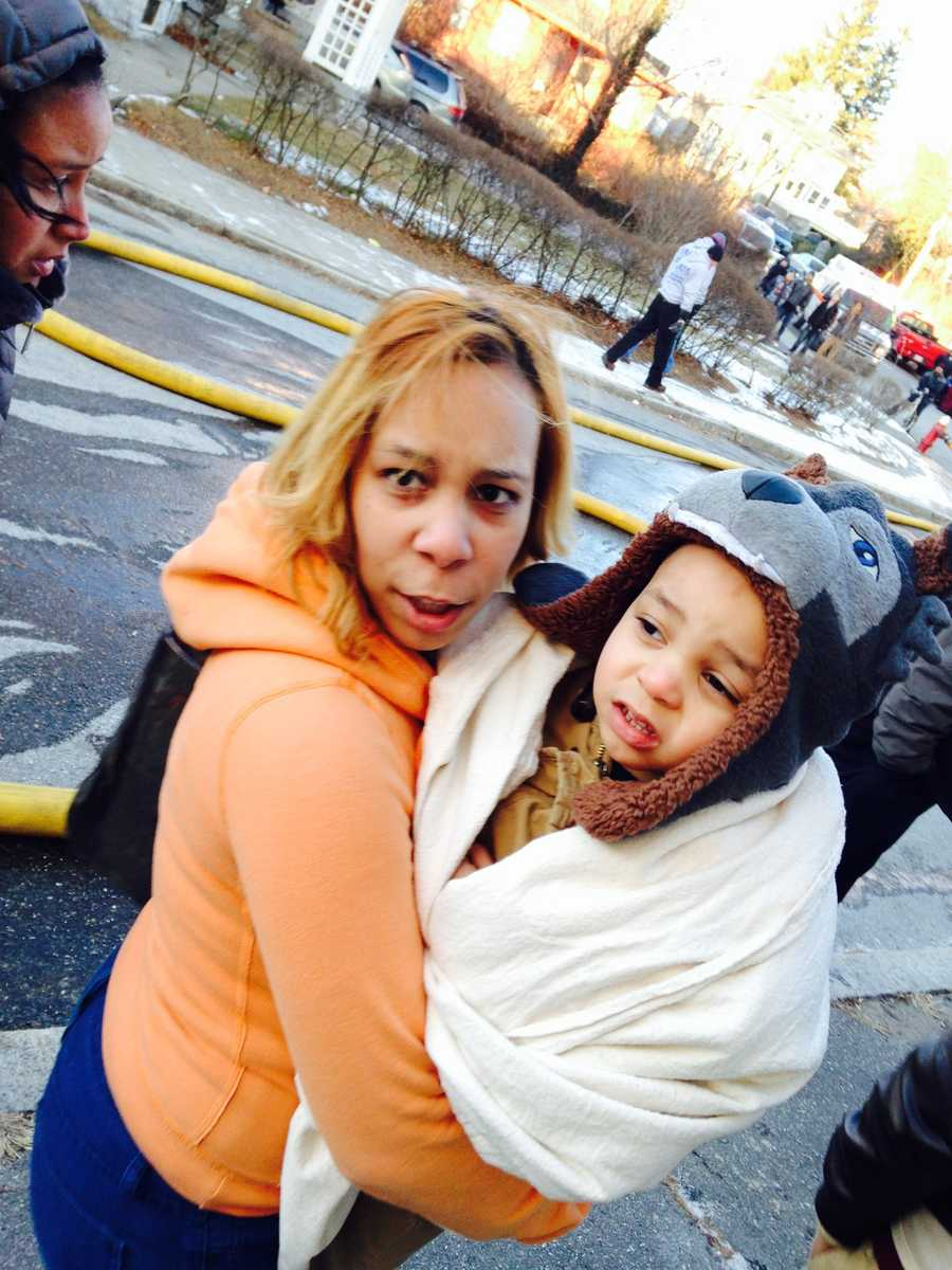 Two of the 12 victims who are homeless after the large fire that destroyed the two family Lawrence home.