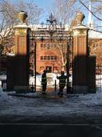 Firefighters in front of Sever Hall in Harvard Yard after unconfirmed reports of explosives forced its evacuation