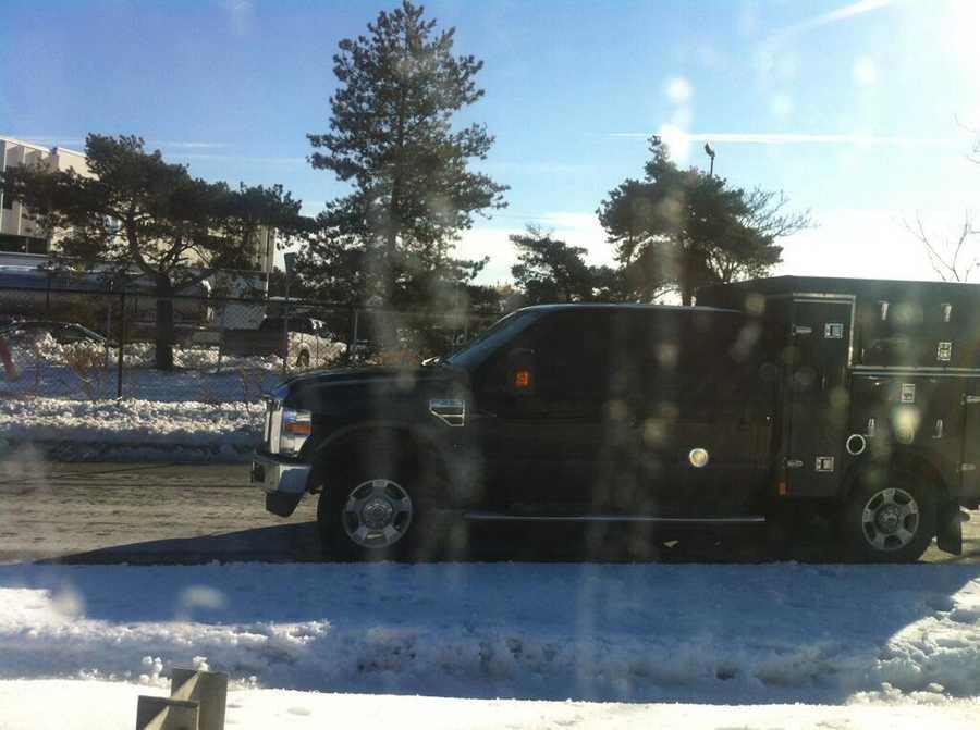 An emergency vehicle heading toward Harvard.