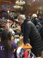 Harvard President Drew G. Faust reassures students waiting in Annenberg Hall after evacuations.