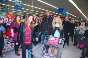 Christmas came early for Walmart shoppers in Tewksbury Friday night as Beyonce played Santa.