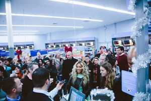 The Grammy-award winning superstar made a surprise appearance at Tewksbury's Walmart on Main Street before her concert at the TD Garden in Boston.