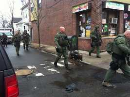 Police said an armed man barricaded himself and his family inside a home in Somerville.