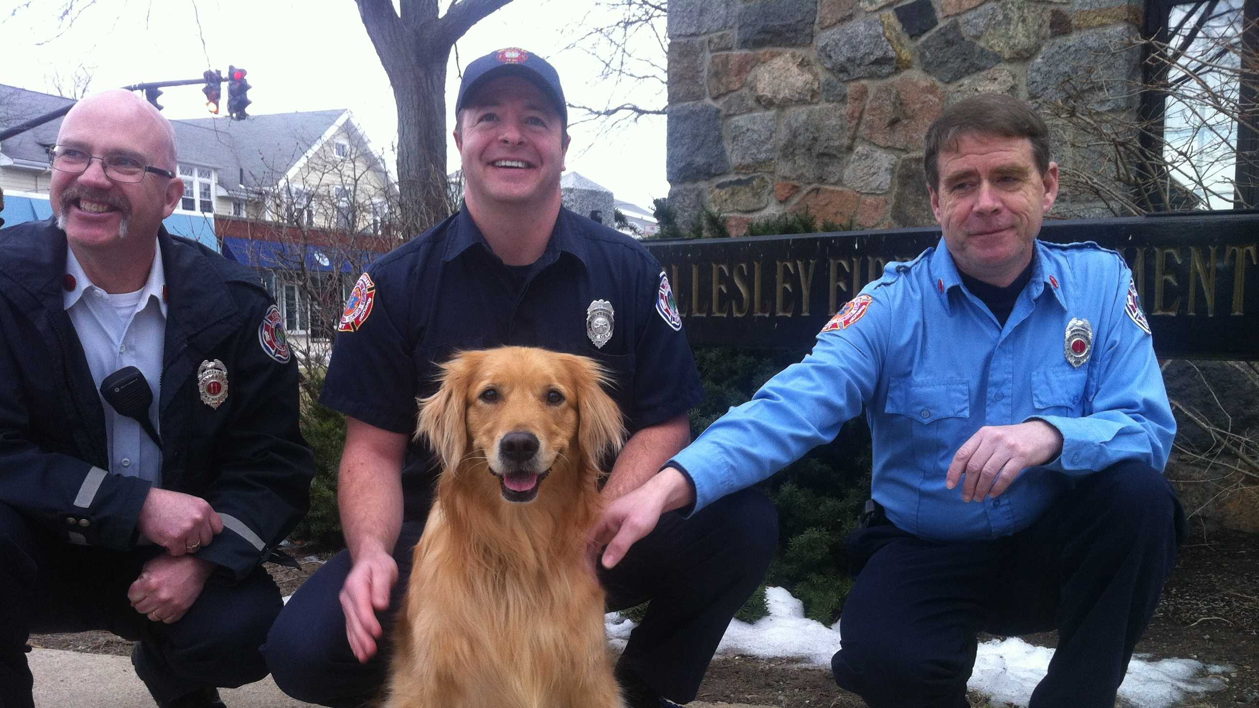 Crosby with Wellesley Fire Capt. Jim Dennehy (L), firefighter Dave Papazian and Lt. Paul Delaney (R).