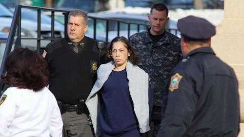 Elsa Oliver, of Fitchburg, is taken from court, Tuesday, December 24, 2013