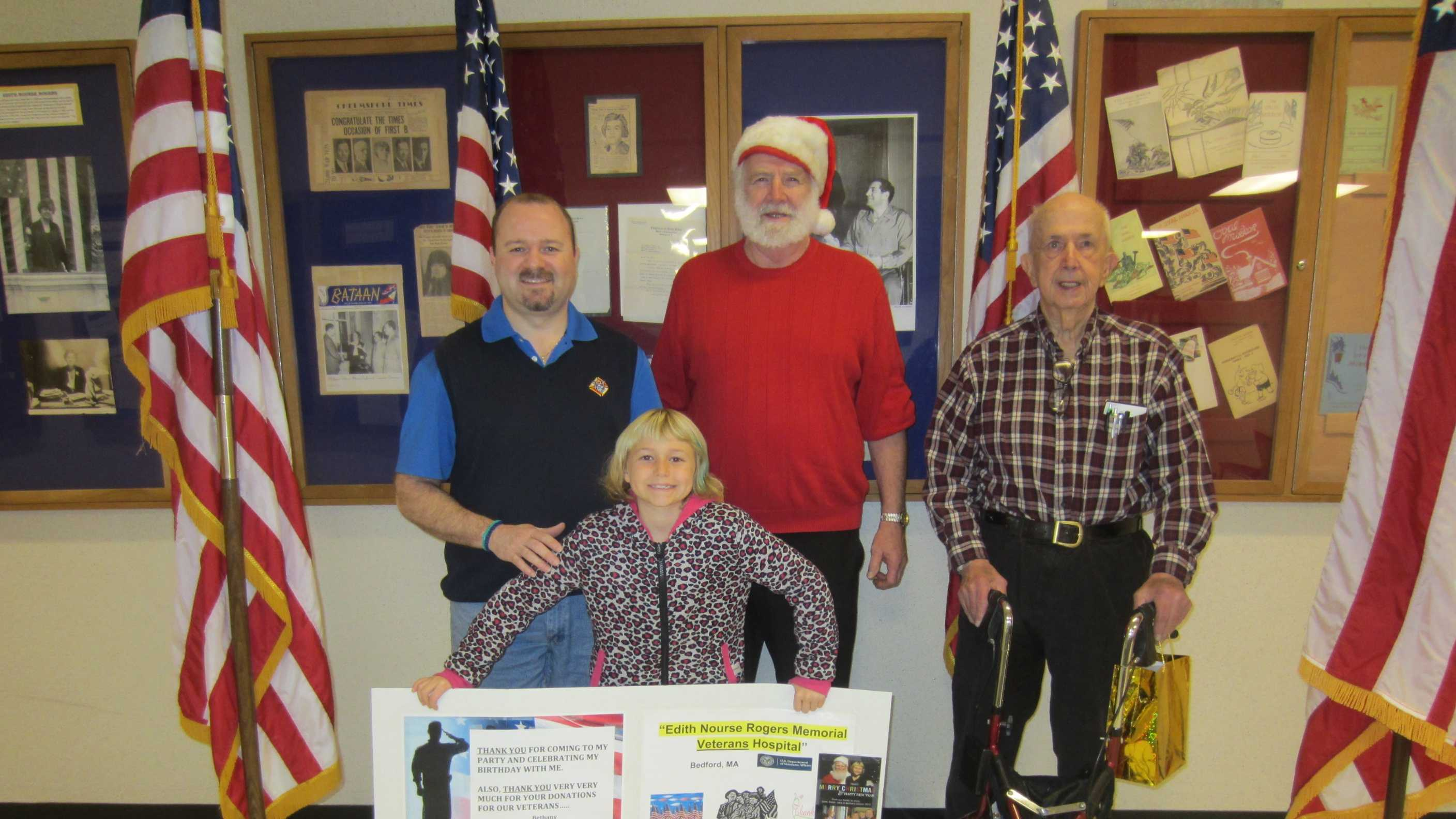 Mike and Bethany Gibson with Paul Harrington and  James Burke at the Bedford Veterans Hospital.