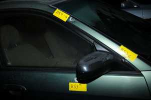 Bullet holes in cars parked at Sandy Hook Elementary School.