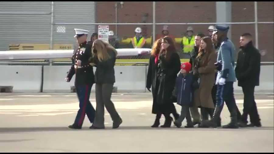 His wife and family are escorted.