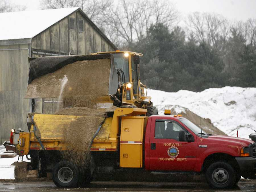 A sander is filled with a salt and sand mix at the Norwell DPW facility off Main Street Thursday morning.