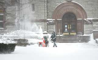 John Marsters, of Weymouth, custodian for the Thomas Crane Library in Quincy, clears walkways. Blizzard conditions affected travel and pedestrians, as a winter storm hit Quincy, Thursday, Jan. 2, 2014.
