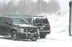 State Police had the northbound lane of Quincy Shore Drive closed due to floodiing at high tide. Blizzard conditions affected travel and pedestrians, as a winter storm hit Quincy, Thursday, Jan. 2, 2014.