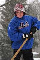 Jaden Rec,10, of Brockton, helps clear his aunt's driveway in West Bridgewater during a snowstorm on Thursday, Jan. 2, 2014.