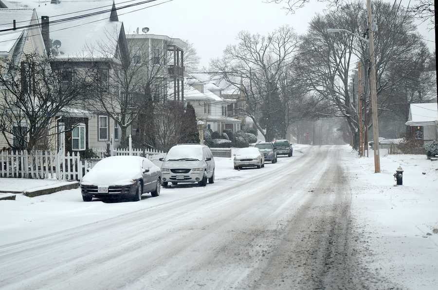 While the main roads are clear, many side roads like Belmont Ave. are still snow-covered during the storm on Thursday, Jan. 2, 2014.