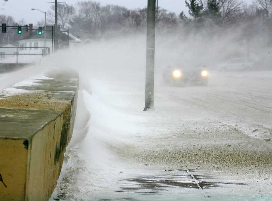 As State Police had sections of Quincy Shore Drive closed during high tide, drifting blowing snow created near white out conditions. Blizzard conditions affected travel and pedestrians, as a major winter storm hit Quincy, Thursday, Jan. 2, 2014.