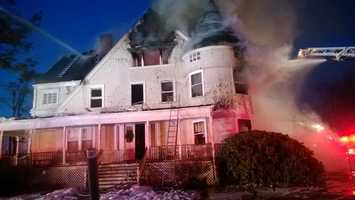 Firefighters were battling a three-alarm blaze at a single-family home at 355 Newtonville Ave. in Newton on Saturday, fire officials said.