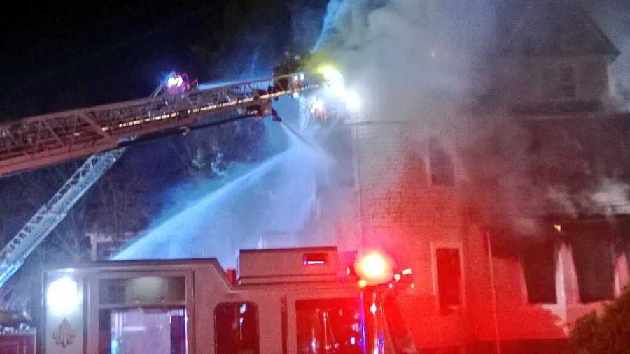 All firefighters have been ordered out of the three-story Victorian-style home, the Newton Fire Department tweeted just before 5 p.m.