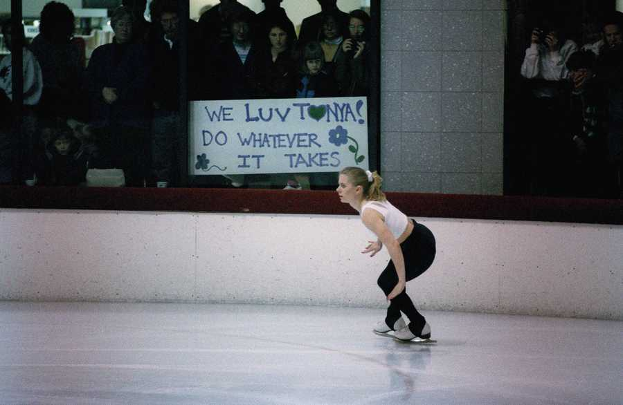 Harding skates past a sign of support as she prepares in Portland, Ore., Feb. 4, 1994, for the upcoming Lillehammer Winter Olympic Games.