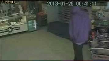 Surveillance video shows two men entering Clark's store on Jan. 29, 2013.