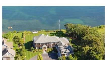 Oceanfront Estate property located on Warren Cove with over an acre of land & private stairs to the water's edge.