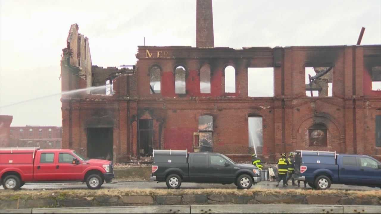 Investigators in Lawrence are preparing to search for evidence after a massive fire consumed an old, closed paper mill in the city.