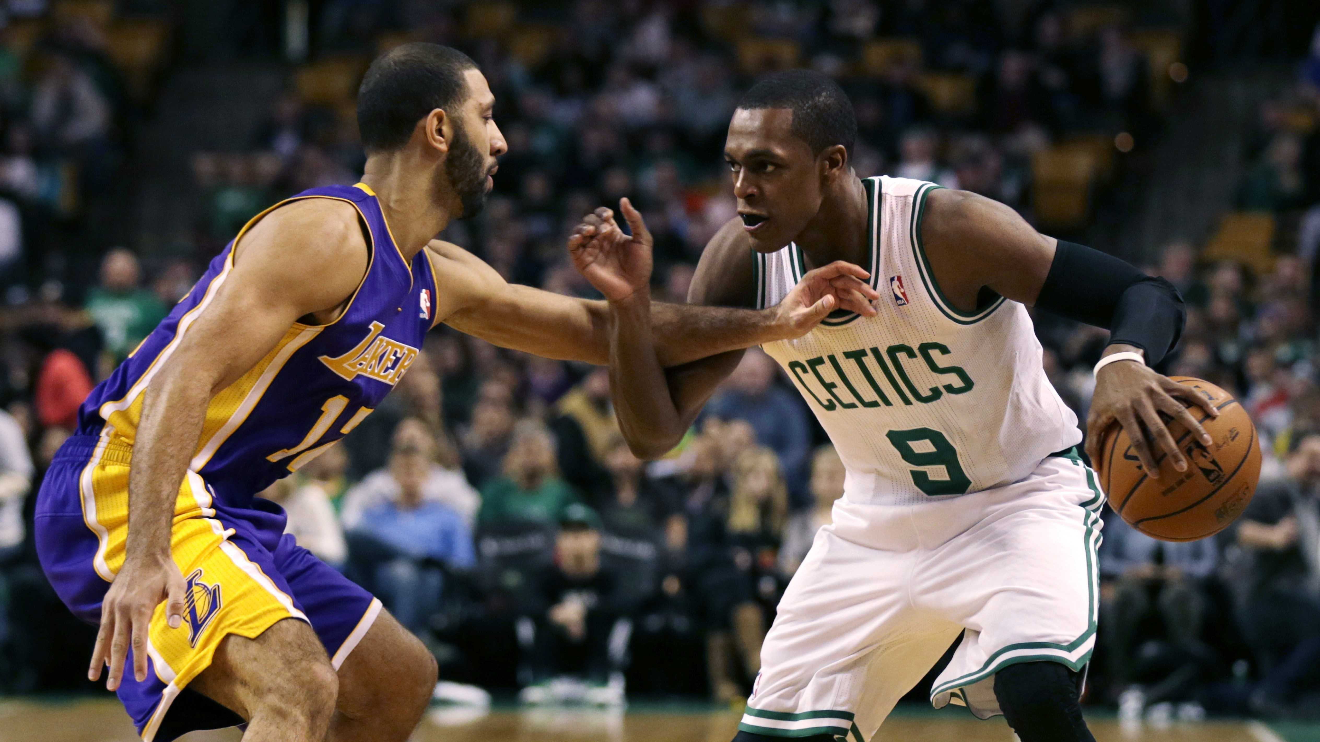 Boston Celtics guard Rajon Rondo (9) tries to drive past Los Angeles Lakers point guard Kendall Marshall, left, during the first quarter of an NBA basketball game in Boston, Friday, Jan. 17, 2014. Rondo returned to the court for the first time this season, after undergoing surgery on his right knee.