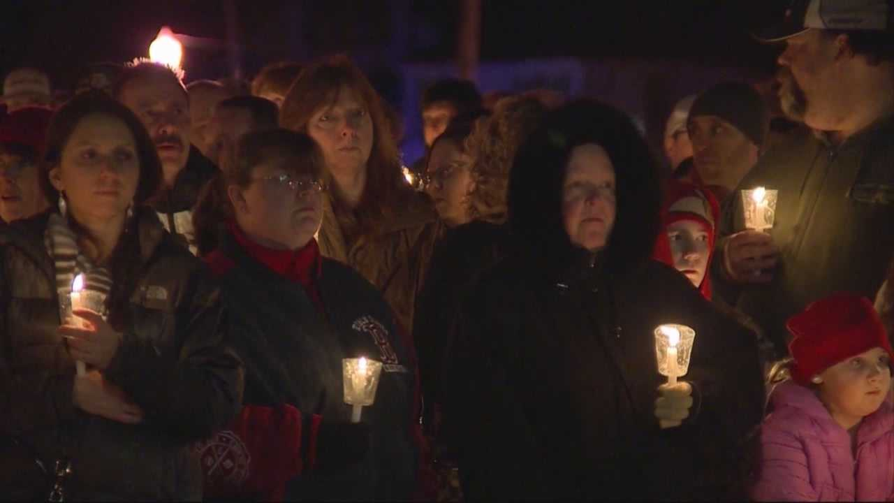 Hundreds filled the town common for a Friday night vigil to remember two young lives lost and to offer comfort to their grieving family.
