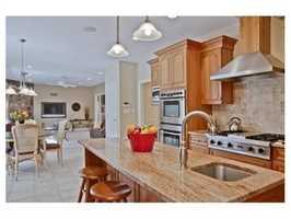 The kitchen has a granite center island.