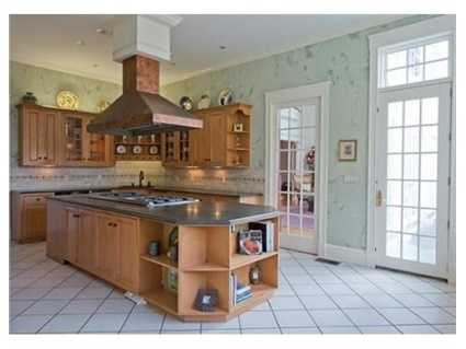 A professional kitchen with a Viking stove.