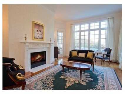 First floor features formal living room with fireplace.