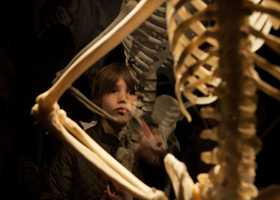 "Alessandro Long, 10, reacts to a skeleton specimen in the exhibit. ""It's interesting to learn a lot,"" says Long. ""Our body is more than bones, there are inside organs and muscles too."" The exhibit will continue until this April."