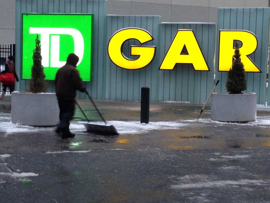 Workers clear the area in front of the TD Garden on Wednesday.