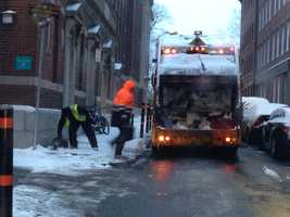 The bitter cold temps,not the snow, was more of an issue for sanitation workers in Boston early Wednesday.