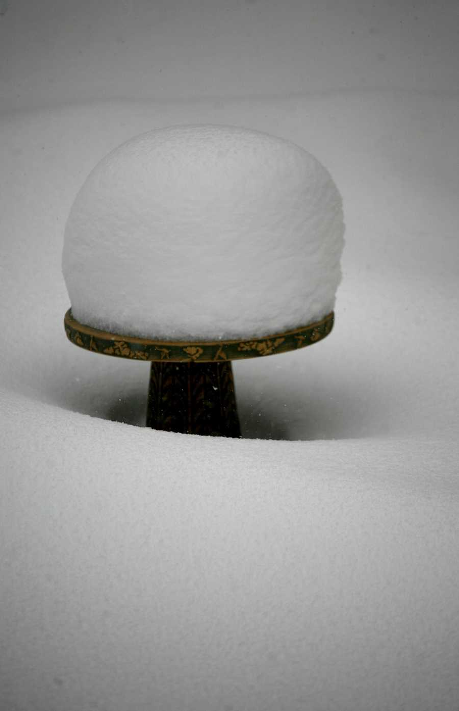 Nearly 20 inches of snow covers spots on the South Shore, Wednesday Jan. 22, 2014. In Marshfield, snow tops a backyard birdbath.