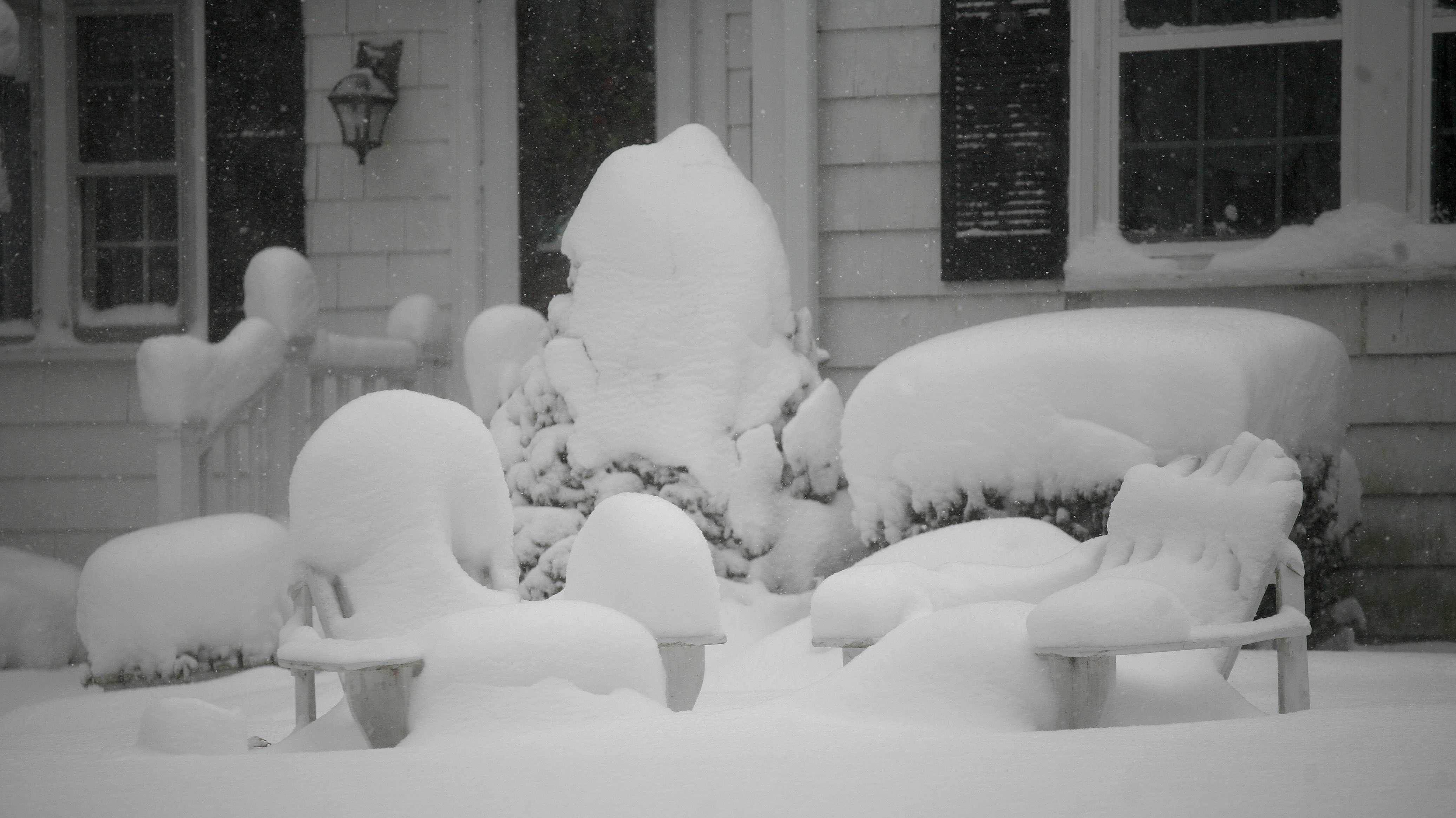 Nearly 20 inches of snow covers spots on the South Shore, Wednesday Jan. 22, 2014. Wooden lawn furniture covered in light fluffy snow over a foot deep.